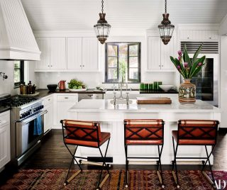 Kitchen and breakfast bar at Alessandra Ambrosio's Santa Monica home, designed by renowned interior designer Martyn Lawrence Bullard