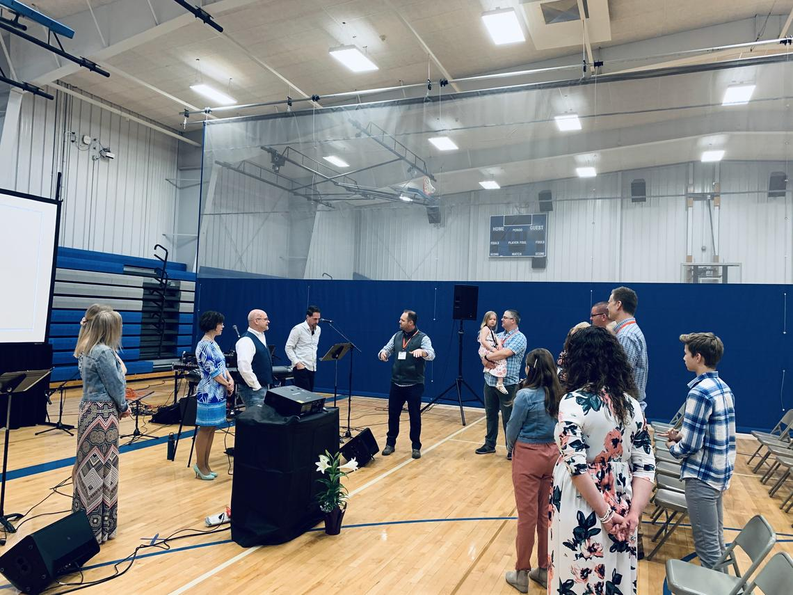 The Bethel Church Kindred Campus worship team practices and the core team prays before people arrive for the first worship service in Kindred, N.D.,, on Sunday, April 4, 2021. Special to The Forum