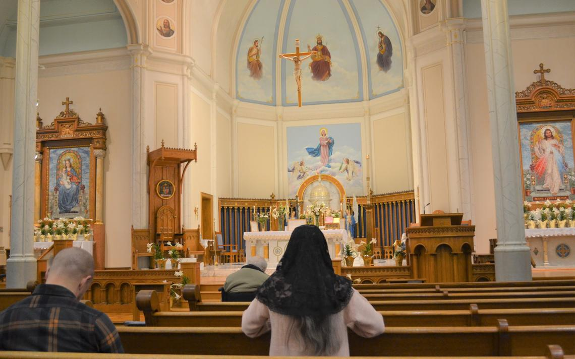 A veiled woman prays the Rosary before the Traditional Latin Mass at the Cathedral of St. Mary in downtown Fargo on Sunday, April 18, 2021. Roxane B. Salonen / The Forum