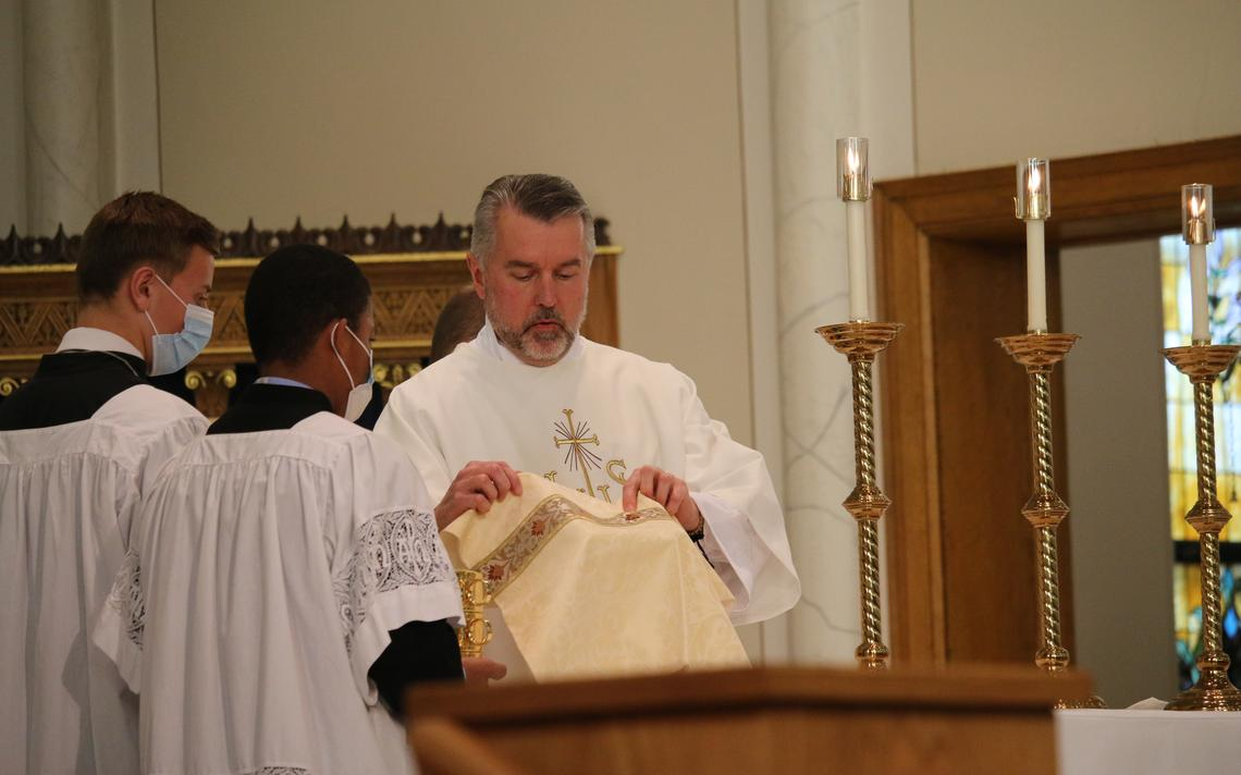 Newly ordained Deacon Ben Seitz prepares the altar during his ordination Mass on Oct. 31, 2020, at St. Mary's Cathedral in Fargo. Photo by Kristina Lahr / Special to The Forum