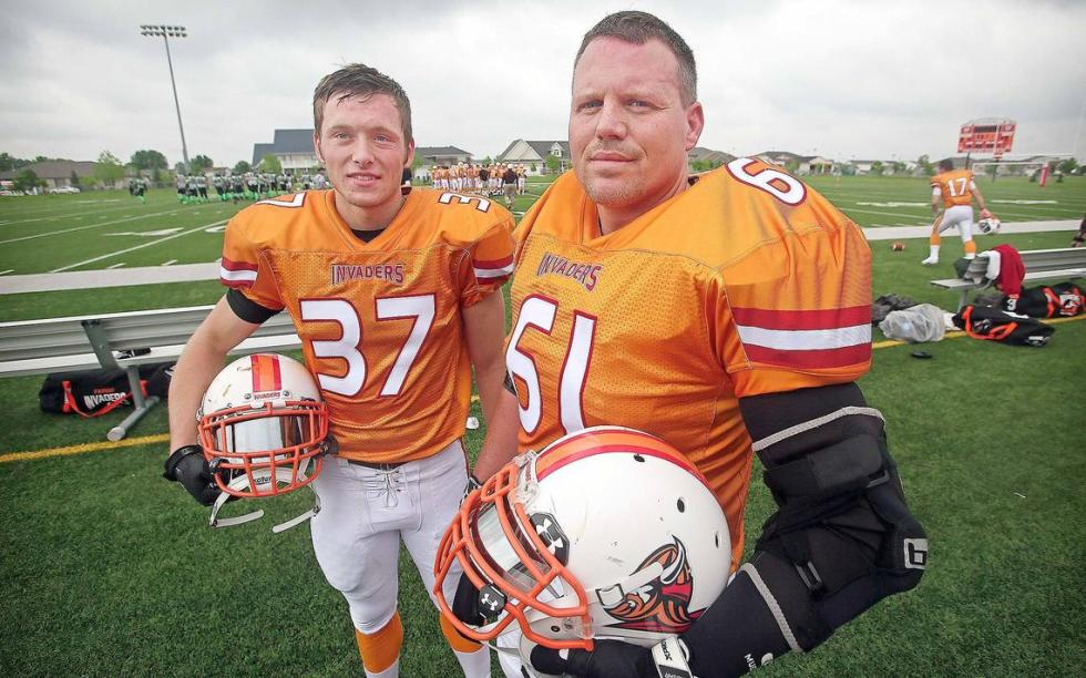 Gage McQuade (left) and his father Chad McQuade both play for the Fargo Invaders semi-pro football team.   David Samson / The Forum
