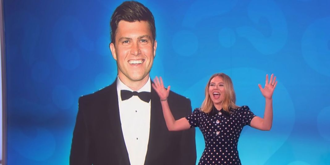 Scarlett Johansson in The Ellen Show, behind her there's a picture of her fiance, Colin Jost