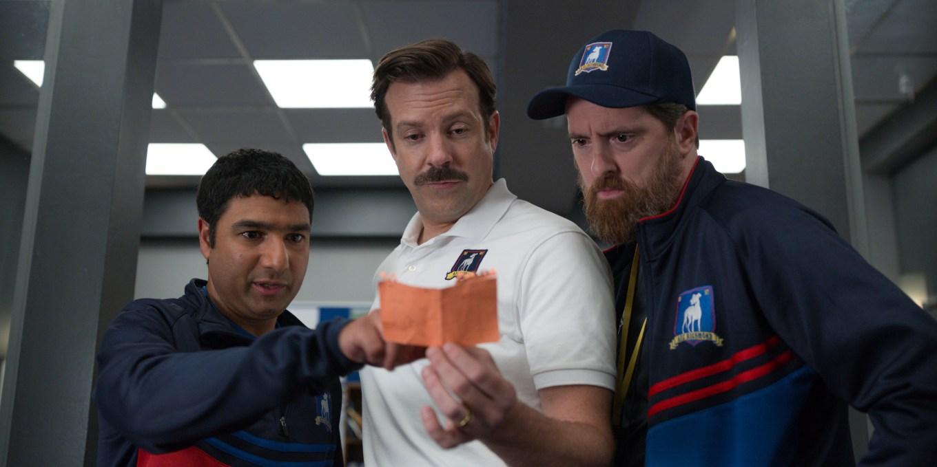 """Nick Mohammed, Jason Sudeikis, and Brendan Hunt in """"Ted Lasso,"""" now streaming on Apple TV+."""