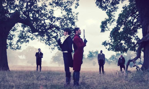 """Jonathan Bailey as Anthony Bridgerton and Rege-Jean Page as Simon Basset in the middle of a duel field in Bridgerton's """"An Affair of Honor"""""""