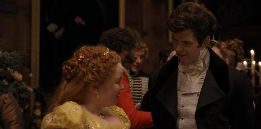 "Nicola Coughlan and Luke Newton as Penelope Featherington and Colin Bridgerton in Netflix's Bridgerton ""An Affair of Honor"""