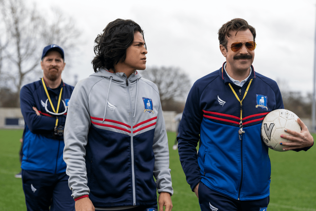 """Brendan Hunt, Cristo Fernández and Jason Sudeikis in """"Ted Lasso,"""" Season Two Episode One: """"Goodbye Earl"""" premiering July 23, 2021 on Apple TV+."""