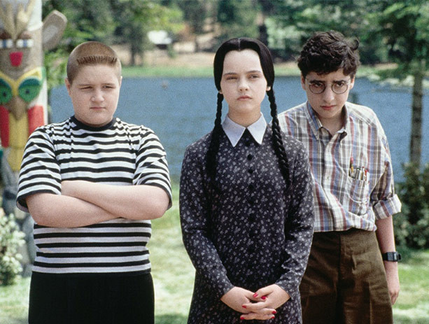 Pugsley and Wednesday Addams with Joel Glicker in Addams Family Values