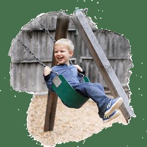 child swinging on playground