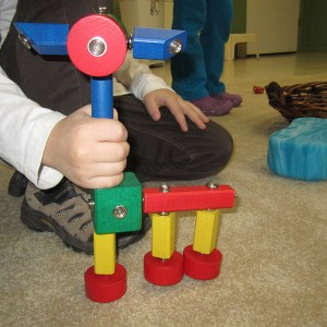 boy building with snap blocks at Marvelously Made School