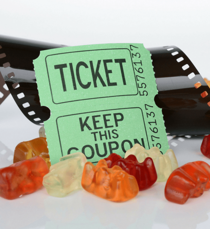 a couple tickets surrounded by gummy bears