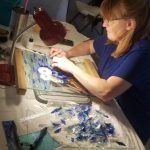 Student working on Glass on Glass Project