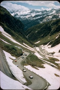 Alps, cars, roads, snow covered mountains