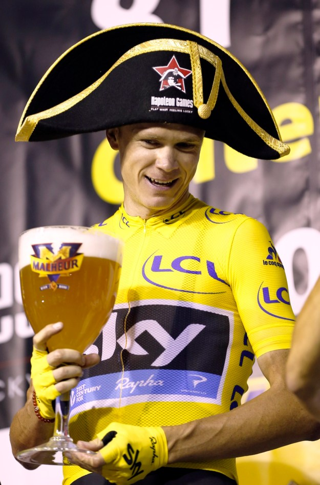 Chris Froome wins the Natourcriterium in Aalst, Belgium and receives a very big beer and a very silly hat.