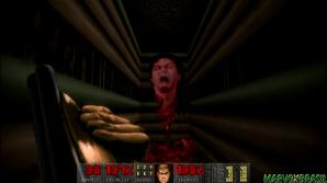 Uma enorme parede esconde a cabeça de John Romero, um dos criadores do jogo que chega a intimar o jogador.