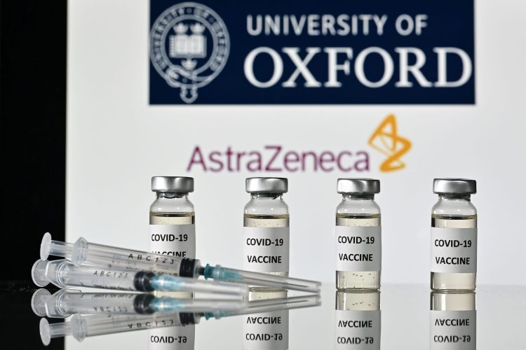 (FILES) This file illustration photo taken on November 17, 2020 shows vials with Covid-19 Vaccine stickers attached and syringes, with the logo of the University of Oxford and its partner British pharmaceutical company AstraZeneca. - France will decide on February 2, 2021 if the Covid-19 vaccine manufactured by AstraZeneca can be used to vaccinate elderly recipients. (Photo by JUSTIN TALLIS / AFP)