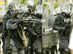 riot-cops-with-guns-reuters