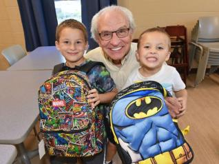 Pastor Kent Clark, CEO of Grace Centers of Hope, with kids from the nonprofit's childcare program.