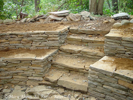The stone steps we built six years earlier were incorporated into the new wall system