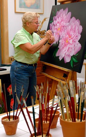 Mary Ahern the Artist at her painting easel in the studio
