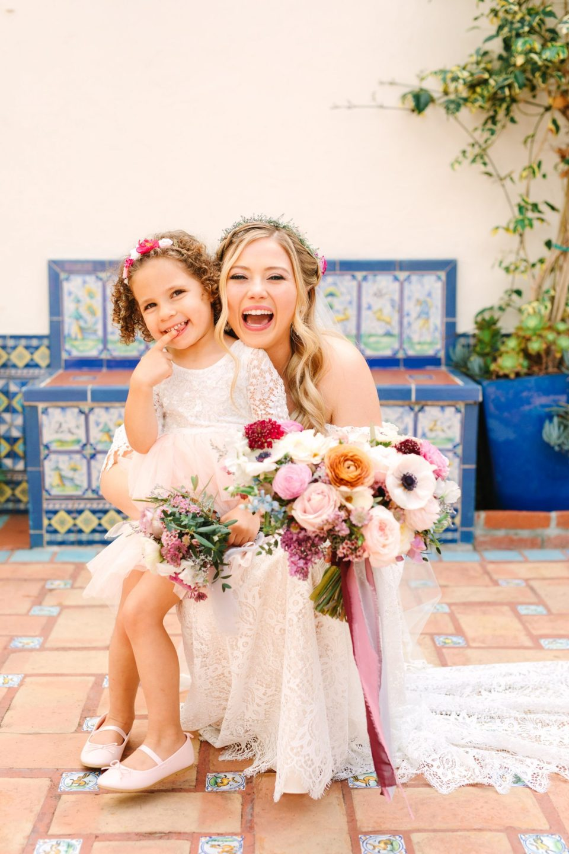 Bride with flower girl - www.marycostaweddings.com