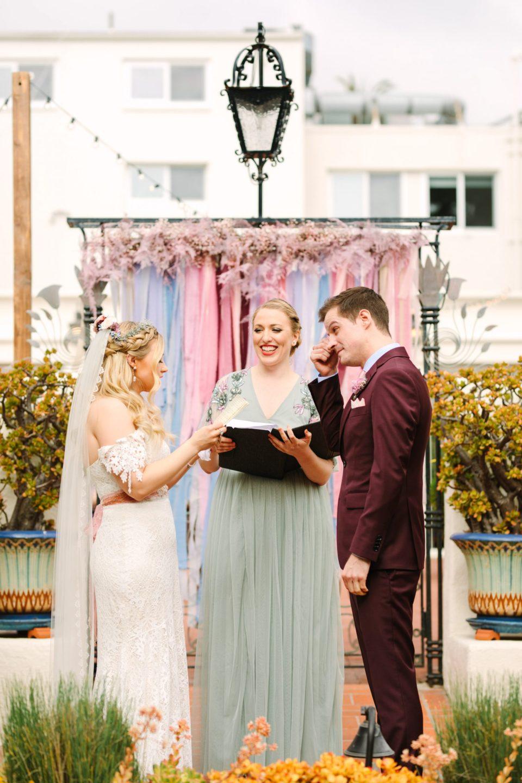 Bride and groom reading vows - www.marycostaweddings.com