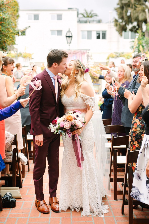 Bride and groom kissing at wedding - www.marycostaweddings.com