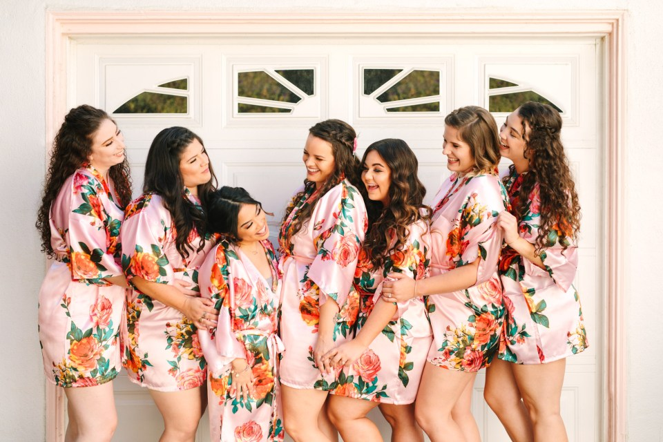 Bridesmaids in floral robes by Mary Costa Photography