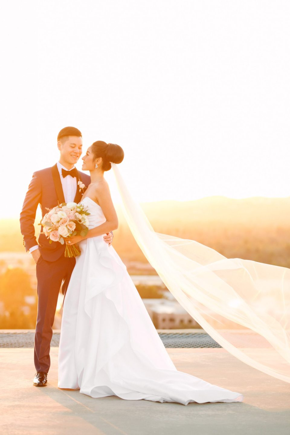 Bride and groom on rooftop at Beverly Hills Four Seasons by Mary Costa Photography