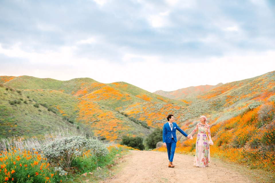 Couple on Walker Canyon poppy trail by Mary Costa Photography