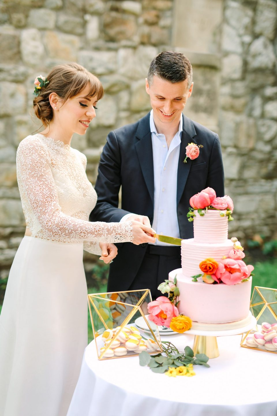 Bride and groom cutting wedding cake by Mary Costa Photography