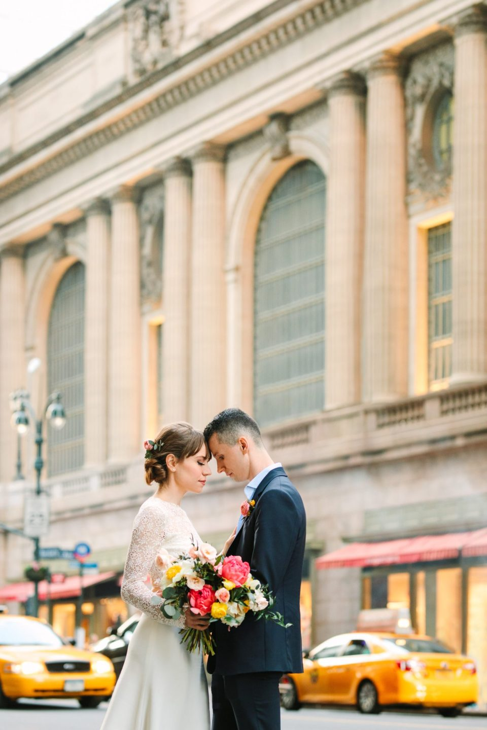 Bride and groom by NYC's Grand Central Station by Mary Costa Photography