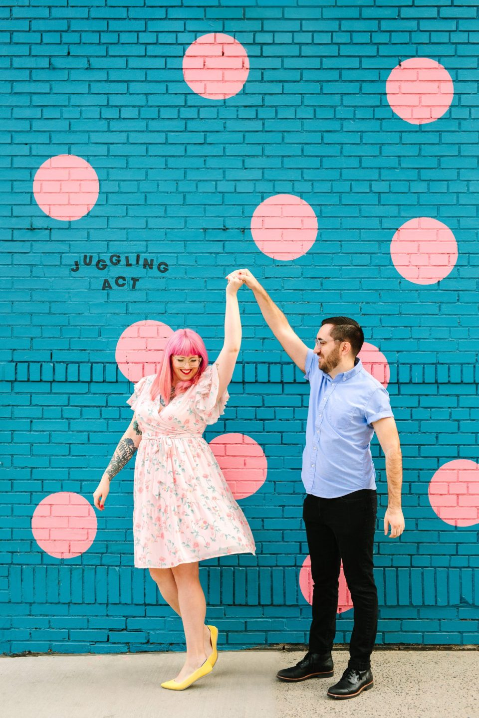 Colorful couple twirling by Mary Costa Photography