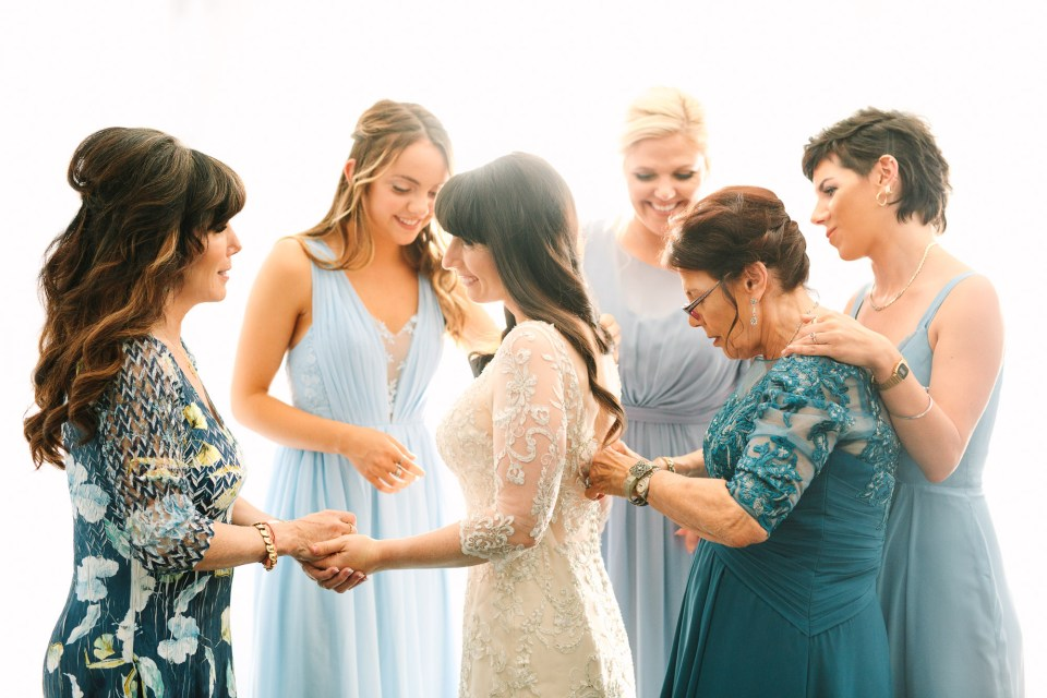 Bride getting ready by Mary Costa Photography