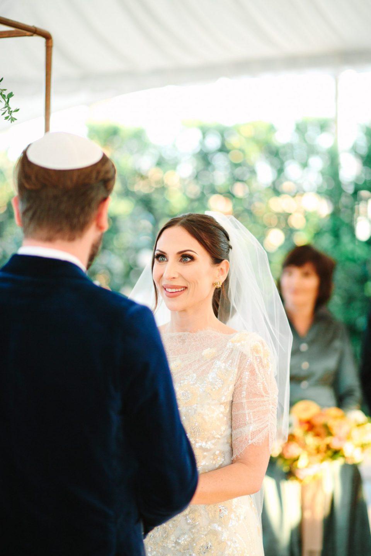 Bride looking at groom during wedding ceremony www.marycostaweddings.com