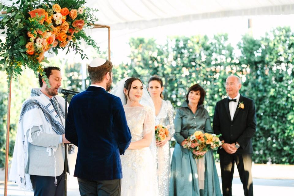 Bride gazing at wedding guests during ceremony www.marycostaweddings.com