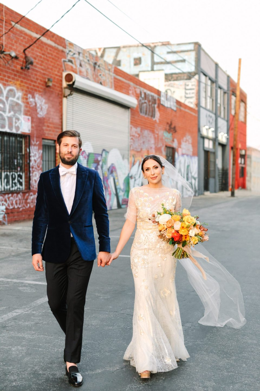 Bride and groom walking in DTLA Arts District www.marycostaweddings.com