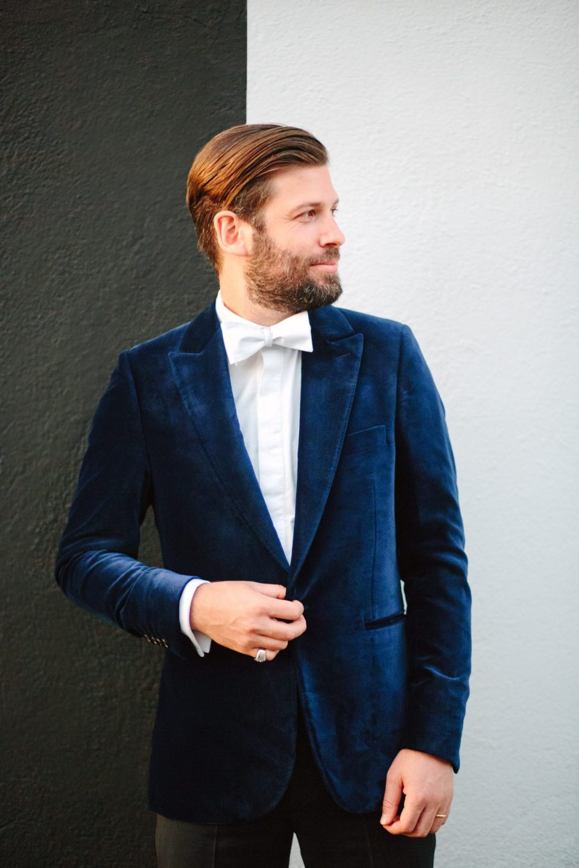 Dapper groom in velvet blue tux www.marycostaweddings.com