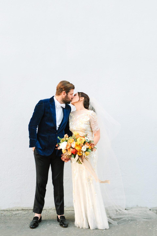 Bride and groom kissing www.marycostaweddings.com