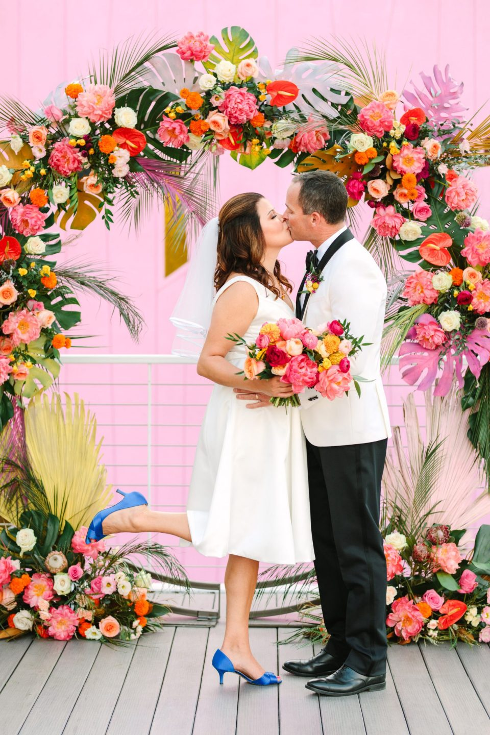 Couple kissing in front of wedding arch at Saguaro Hotel Palm Springs www.marycostaweddings.com