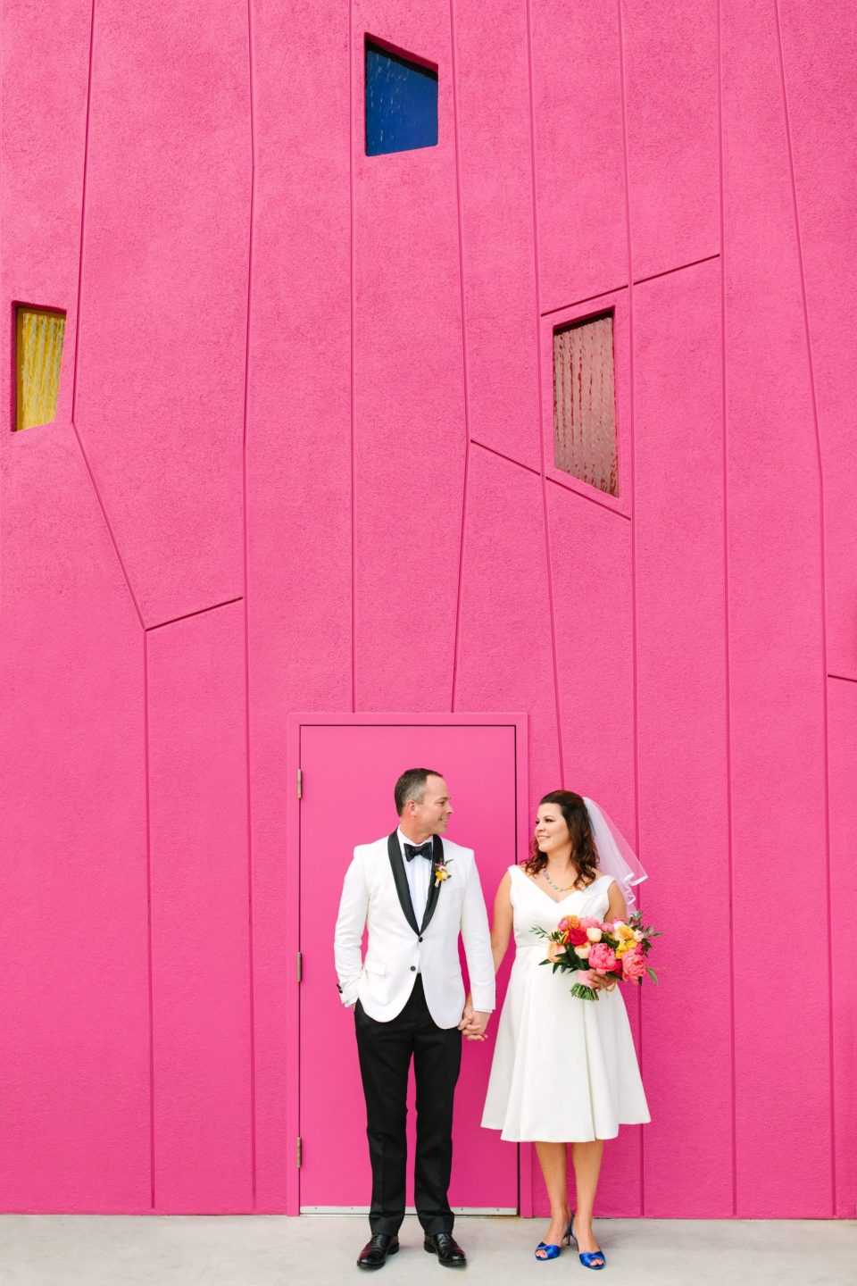 Bride and groom in front of pink wall at Saguaro Palm Springs www.marycostaweddings.com