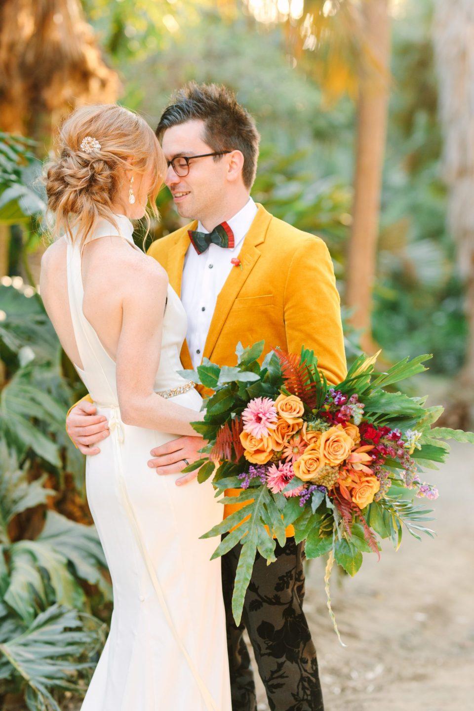 Stylish bride and groom in palm garden - www.marycostaweddings.com