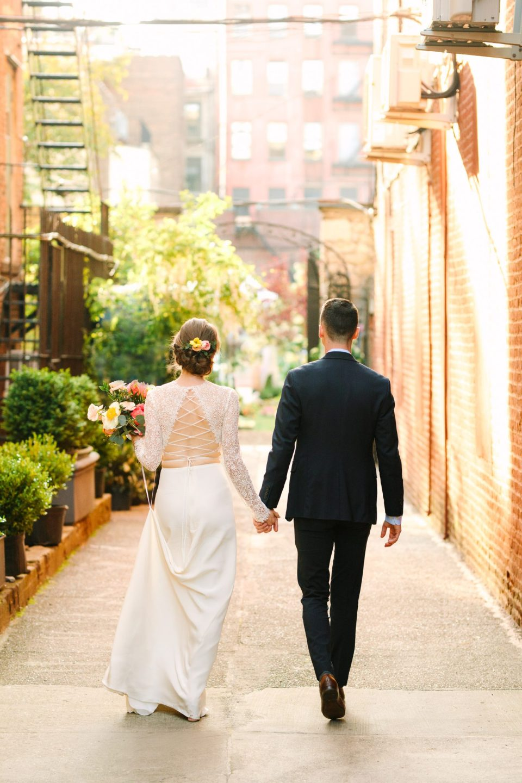 Bride and groom walking in Manhattan - www.marycostaweddings.com