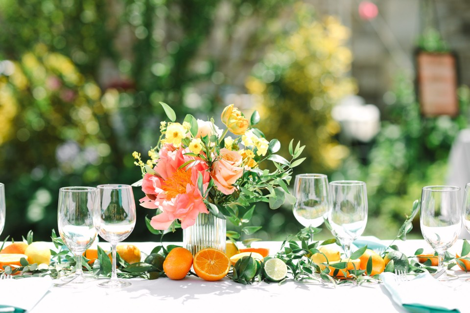 Citrus and flowers at luncheon wedding