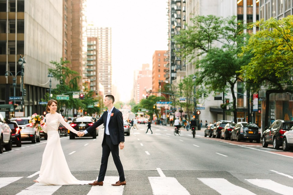 Bride and groom in NYC crosswalk - www.marycostaweddings.com