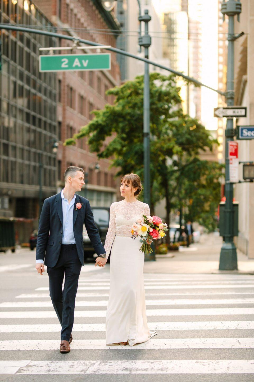 Bride and groom crossing the NYC street - www.marycostaweddings.com