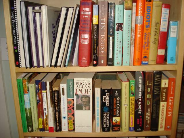 Two shelves of mostly fiction, Mary Warner's homelibrary, November 2014.