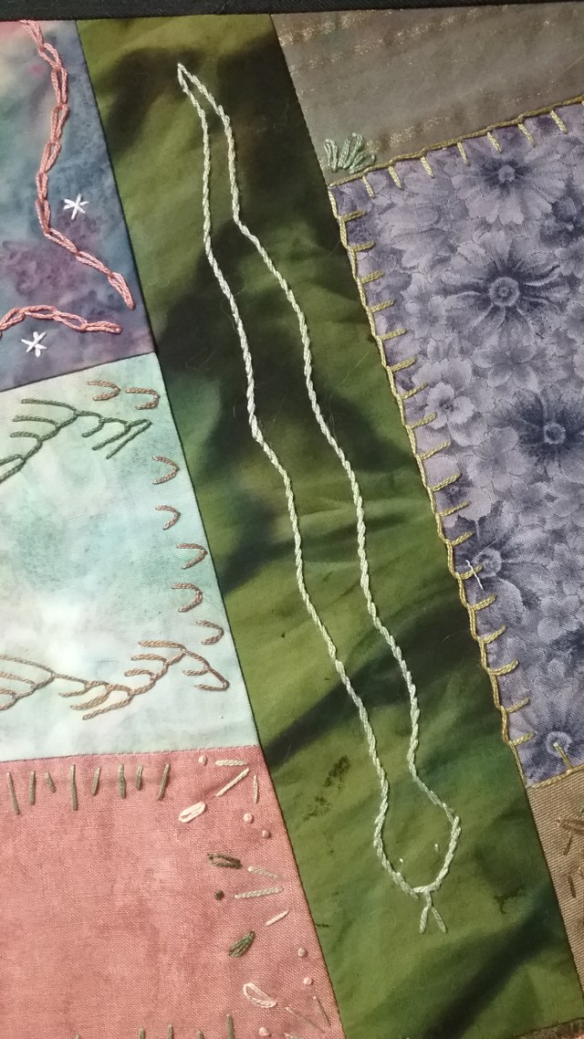 Snake on crazy quilt by Mary Warner, April 3, 2017.