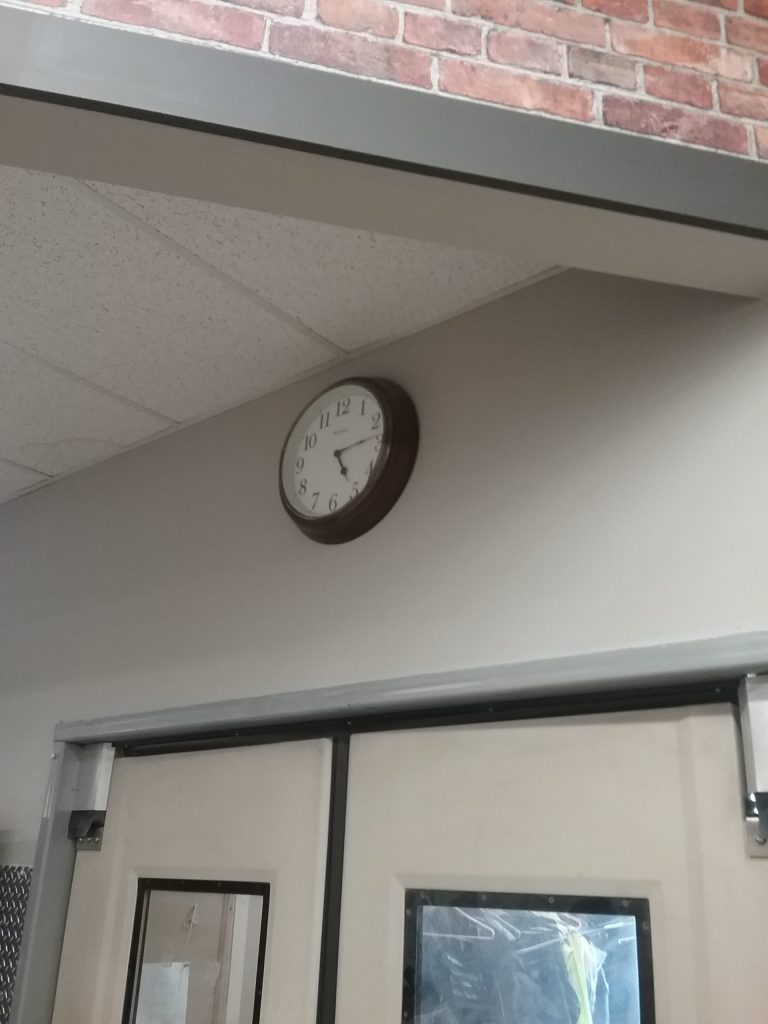 Black and white clock on a wall, 2018.