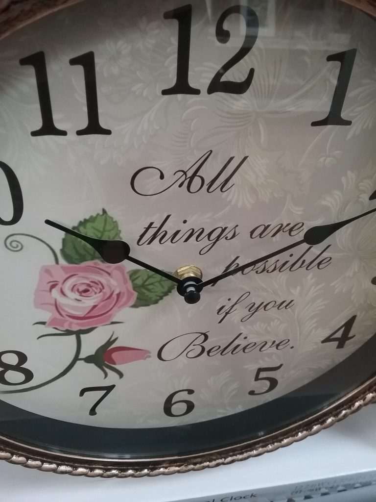 """Clock that says, """"All things are possible if you believe,"""" 2018."""