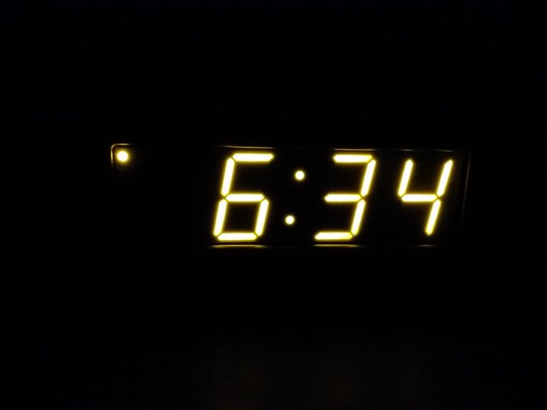 My magic atomic alarm clock at 6:34 p.m. on November 3, 2018, behaving not so much like a slave clock because it doesn't keep exact time. Trust me, there actually is a structure to this clock. It's not so magic that it is merely floating numbers in the dark. Although, that would be cool, wouldn't it?